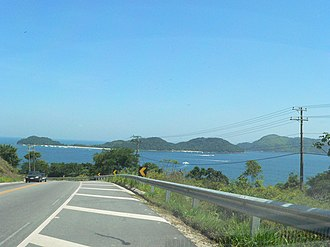 São Sebastião, São Paulo - Two of São Sebastião's islands seen from the BR-101. As Ilhas are in the middle, and the Ilha das Couves can be seen to the right, right behind As Ilhas.