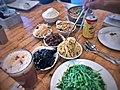 Assorted deli items- wood ear, shredded tofu, shredded potato, bamboo shoots, lotus root, pea shoots, vegetarian Mapo tofu.jpg