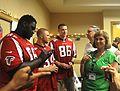 Atlanta Falcons players at NGAGA 2013.jpg