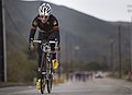 Australian Army Pvt. Kyle Ridgewood, a Wounded Warrior with the Allies Team, pulls ahead of the other cyclists during the last stretch of a 30-kilometer cycling competition for the 2012 Marine Corps Trials 120219-M-YO938-589.jpg