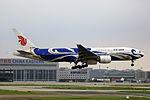 B-2059 - Air China - Boeing 777-2J6 - Blue Phoenix Livery - SHA (10925494646).jpg