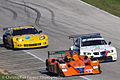 BMW Corvette and LMPC pack of cars After Turn 5 Road America Lemans 2011.jpg