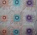 Baby blanket from flower loom motifs shows detail of flowers.jpg