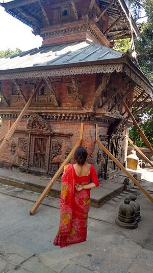 Sankhu Bajrayogini Temple - Women observing temple effected by the earthquake