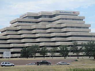 Bank of America - Pyramid-shaped former Bank of America branch building towers over Interstate 410 in San Antonio, Texas.