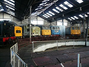 Barrow Hill Engine Shed - A mix of steam, diesel and electric locomotives facing the roundhouse turntable