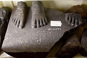 Armant, Egypt - Base of a granite statue inscribed with the name of Senusret (Sesostris) I. Two feet of a female figure, at the right side of the right foot of the king. From Armant, Egypt