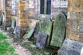 Beelsby Church - Stacked Gravestones - geograph.org.uk - 66411.jpg