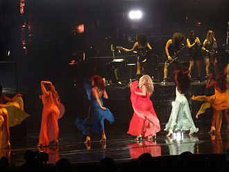 """The Mrs. Carter Show World Tour - Beyoncé and her female dancers performing """"Freakum Dress"""" during a concert. For the performance of the song they wore long dresses in different colours."""