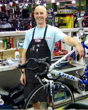 Local bike shop - A bicycle mechanic at a local bike shop.