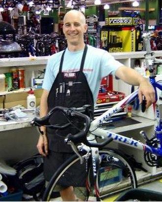Local bike shop - A bicycle mechanic at a local bike shop.