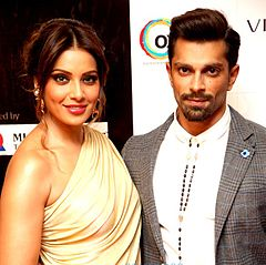 Karan and Bipasha smiles at the camera