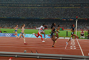 United States at the 2008 Summer Olympics - American Allyson Felix crosses the finish line for a first-place finish in the second 200 m semifinal.