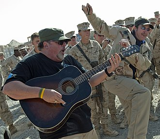 Bob DiPiero - DiPiero (left) performing with Kix Brooks for U.S. troops in Afghanistan on behalf of the USO in December 2010