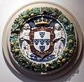 Bottega dei della robbia, angeli con stemma reale del portogallo, 1500-25 ca.jpg