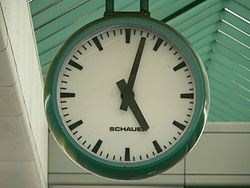 approx. 05:02 (or 05:02) displayed on clock/watch