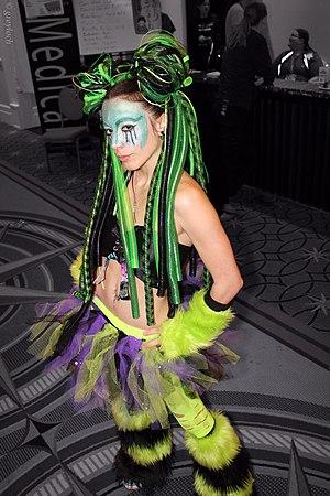 Fluffy (footwear) - A raver wearing green and black furry leg warmers