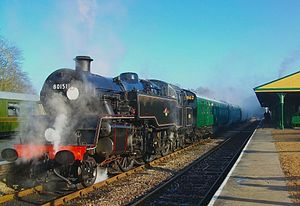 Bluebell Railway - British Railways Class Standard Four No. 80151 and its train are seen at Horsted Keynes