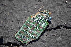 Electronic waste - A fragment of discarded circuit board.
