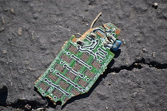 Electronic waste - A fragment of a discarded circuit board.