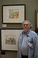 Bruce Degen with some of his work in the Mazza Museum.jpg