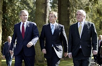 Bertie Ahern - US President George W. Bush, UK Prime Minister Tony Blair, and Ahern at Hillsborough Castle in Northern Ireland on 8 April 2003.