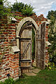 Buttressed wall gate Old Manor House folly Capel Manor Enfield London England.jpg