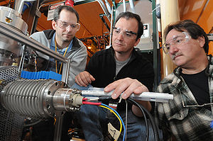 Argonne Tandem Linear Accelerator System - Scientists inspecting the surface ionization source. The source charges the breeder by providing stable beams.