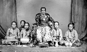 Bugis - Aru Pancana We Tenriolle, Queen of Tanette, South Sulawesi. Pictured accompanied by court ladies.