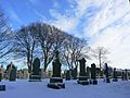 Cemetary in the snow (3262741491).jpg