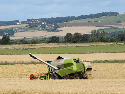 A combine harvester in use in Scotland