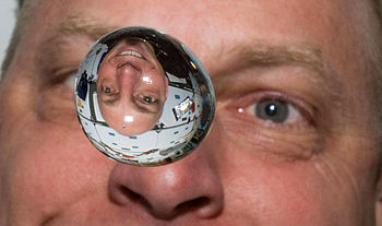 English: Astronaut Clayton Anderson watches as...