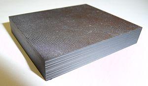 Composite laminate - A small sample of aerospace grade carbon-fibre/epoxy laminate