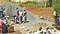Construction site workers loading water, sand, ballast and cememt into a concrete mixer in Embu, Kenya 3a.jpg