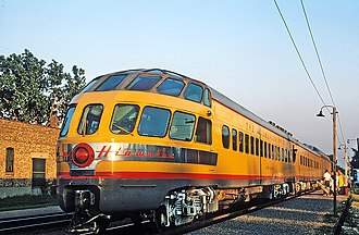 Skytop Lounge - The Coon Rapids on the Twin Cities Hiawatha at Glenview, Illinois in 1964. The car is painted in Union Pacific colors