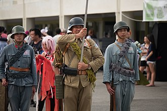 Stahlhelm - Three modern Chinese reenactors dressed as Chinese Nationalist Army soldiers who wore M1935 helmets during World War II.