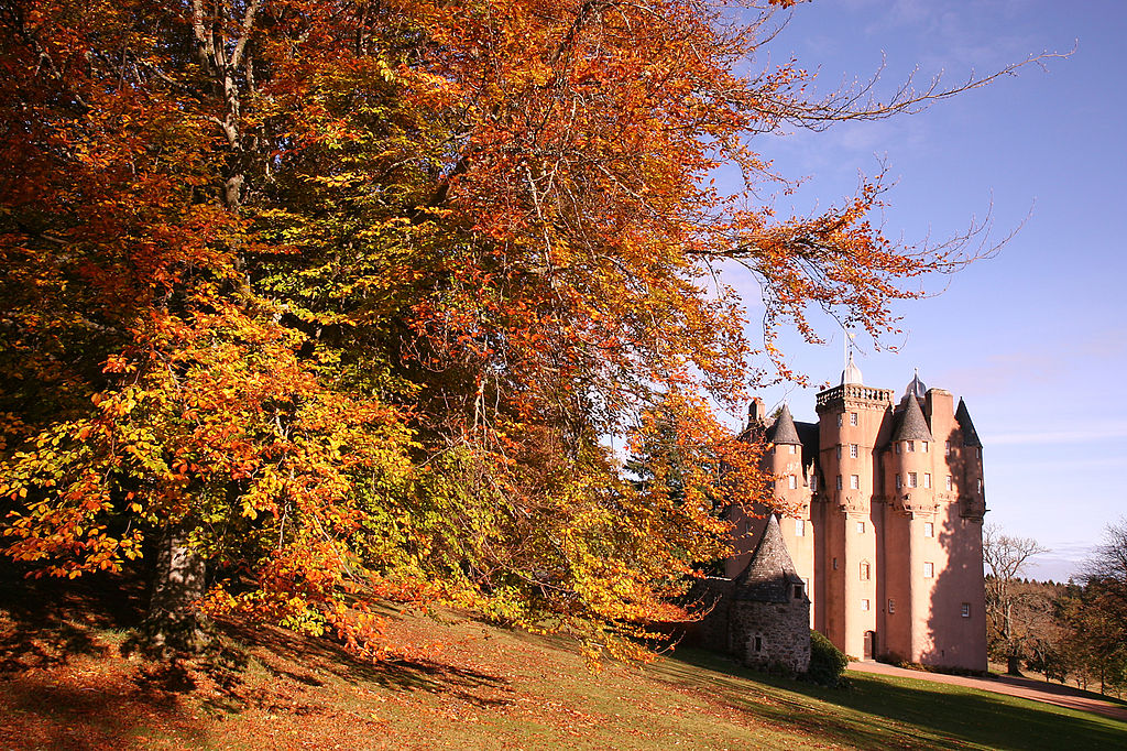 The pink Craigievar Castle during the autumn on a clear day