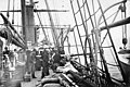 Crew and natives, possibly Siberian Eskimos, on board ship, probably Aleutian Islands, ca 1899 (WARNER 598).jpeg