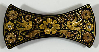 Damascening - Detail of damascening, in this case gold inlaid into oxidized steel, in a hairclasp from Toledo, Spain.