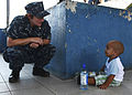 Defense.gov News Photo 100822-M-6740B-269 - U.S. Navy Lt. Traci Burrell talks to a Costa Rican boy at a medical site in Limon Costa Rica during Continuing Promise on Aug. 22 2010. Service.jpg