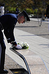 Defense.gov News Photo 110911-F-RG147-262 - An Air Force Honor Guard member places a wreath on a bench in the Pentagon Memorial during the 9 11 remembrance ceremony on Sept. 11, 2011.jpg