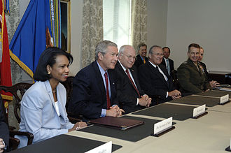 Neoconservatism - President Bush meets with Secretary of Defense Donald Rumsfeld and his staff at the Pentagon, 14 August 2006.