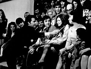 American Bandstand - Dick Clark talks to Myrna Horowitz, one of the original dancers when the program began in 1950, on the show's 17th anniversary in 1970.