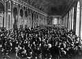 Dignitaries gathering in the Hall of Mirrors at the Palace of Versailles, France, to sign the Treaty of Versailles.jpg
