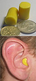 Disposable foam earplugs: out of the ear with coins for scale (top) and inserted into the wearer's ear (bottom). Disposable foam earplugs.jpg
