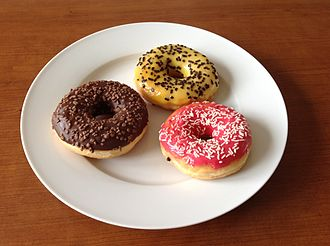 National Doughnut Day occurs on the first Friday of June every year. Donuts with chocolate banana and strawberry.jpg