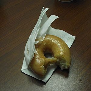 English: Here is a half eaten donut from dunki...