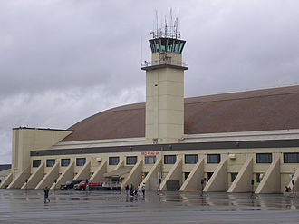 "Eielson Air Force Base - One of two control towers at Eielson Air Force Base.  This tower is structurally attached to the aircraft hangar behind.  The hangar, the base's largest, is known colloquially as ""The Thunderdome""."