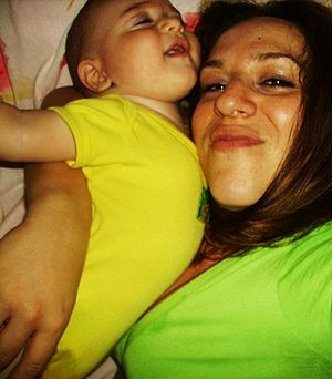 Evi Hassapides Watson with her son, 2009.jpg