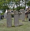 Exterieur, overzicht Kerkhof, twee 18e eeuwse grafstenen met scheepje en huisje. - Hollum - 20327694 - RCE.jpg